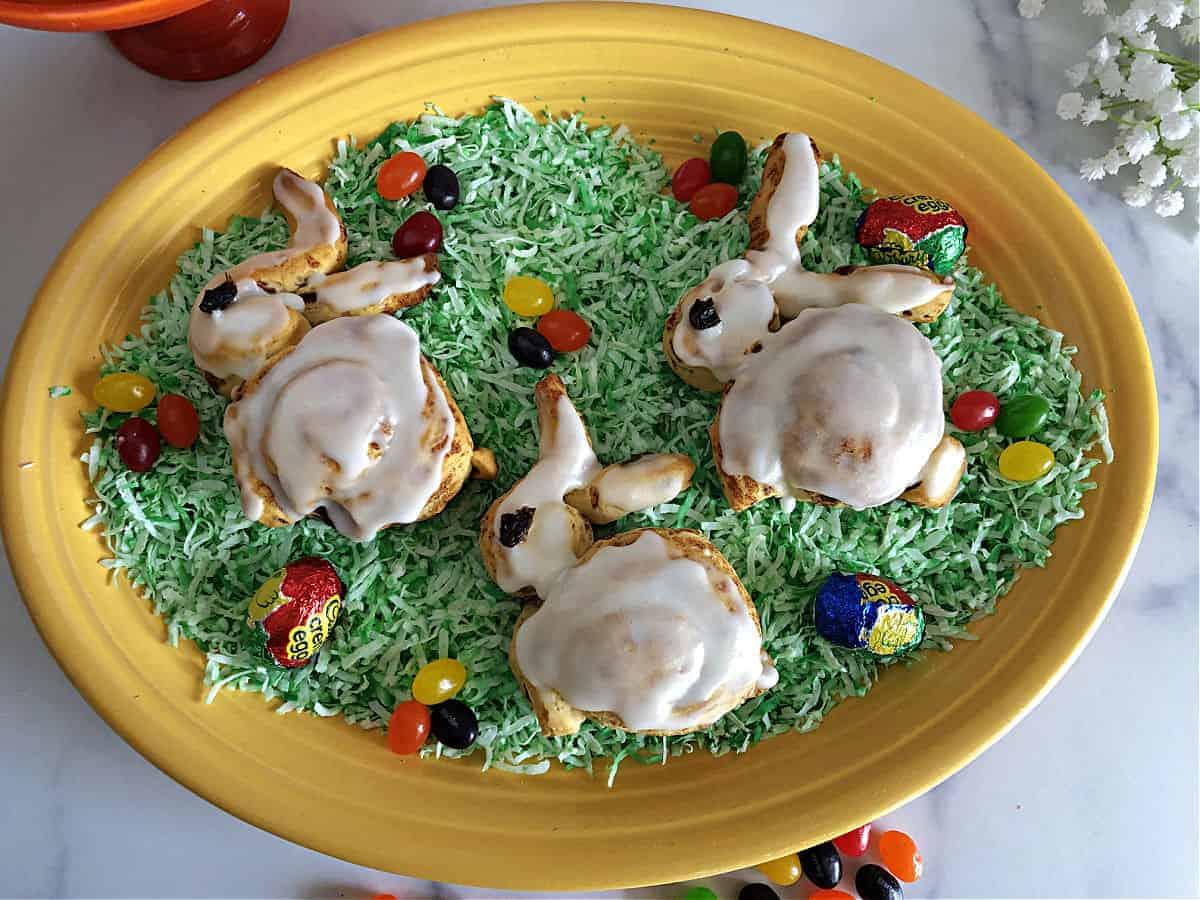 3 Cinnamon bunnies on edible easter grass