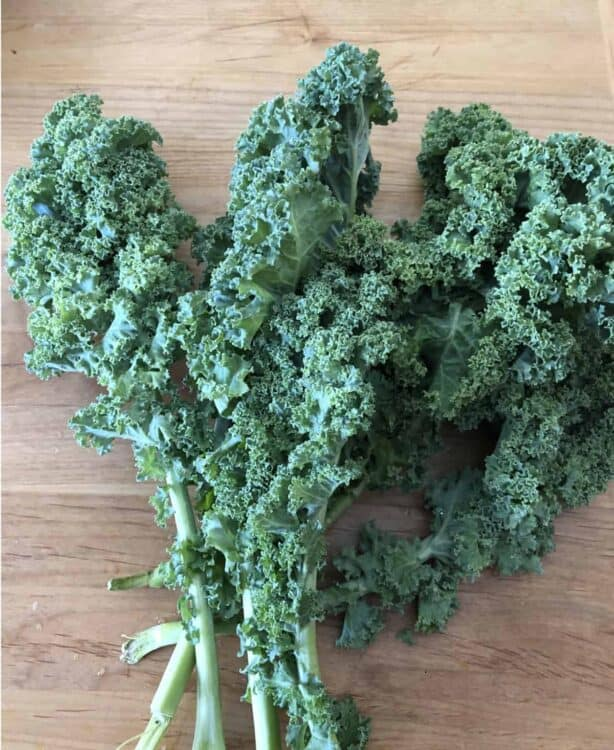 bunch of kale on a cutting board