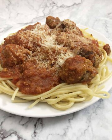 ricotta meatballs in sauce on spaghetti noodles