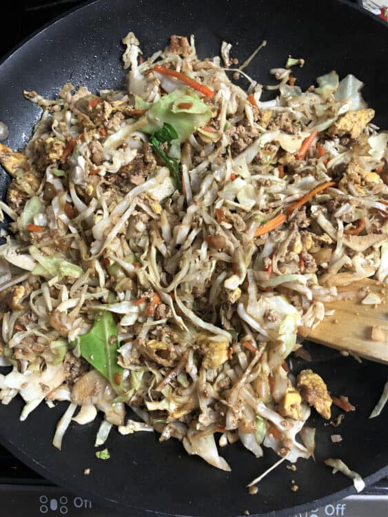 Cole slaw mix added to skillet