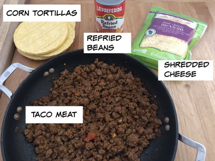ingredient image: taco meat, tortillas, refried beans, shredded cheese