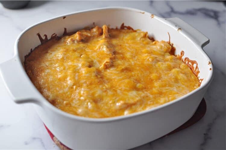 square baking dish containing cheesy casserole