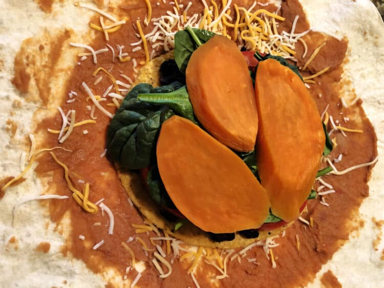 spinacj=h and sweet potato slices added to tostada