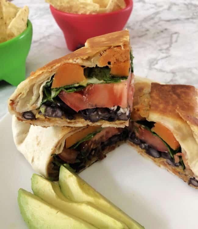 cut crunch wrap showing the veggie layers inside