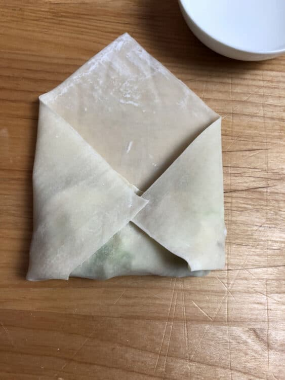 both sides of wrapper folded in