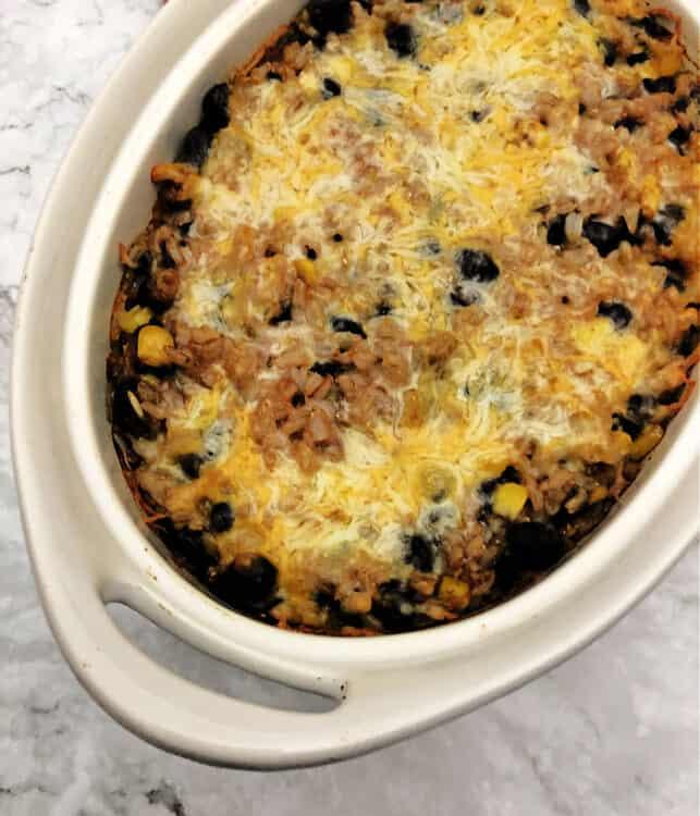 oval casserole dish with baked casserole inside