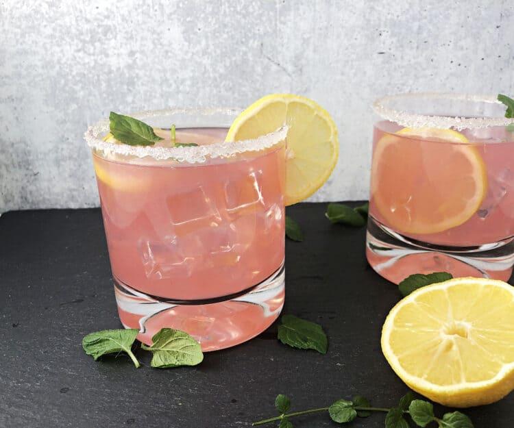 2 ponk senorita drinks garnished with lemons