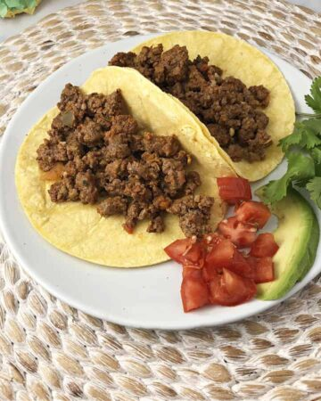 2 corn tortillas filled with taco meat