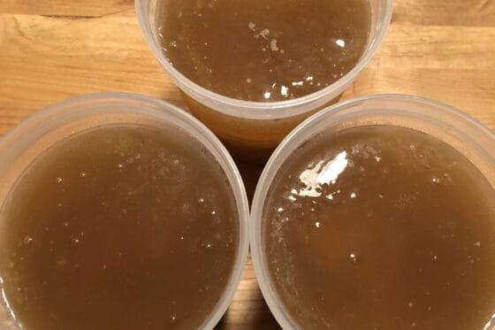 bone broth top down view in 3 jars