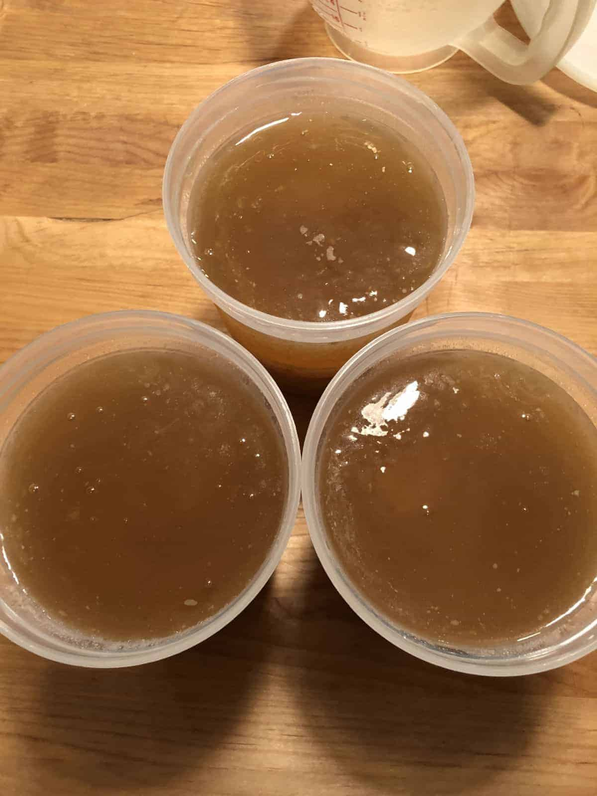 bone broth top down view in 3 jars