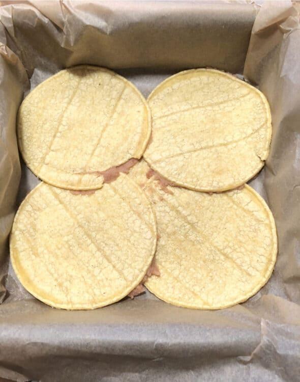 layer of tortillas in pan