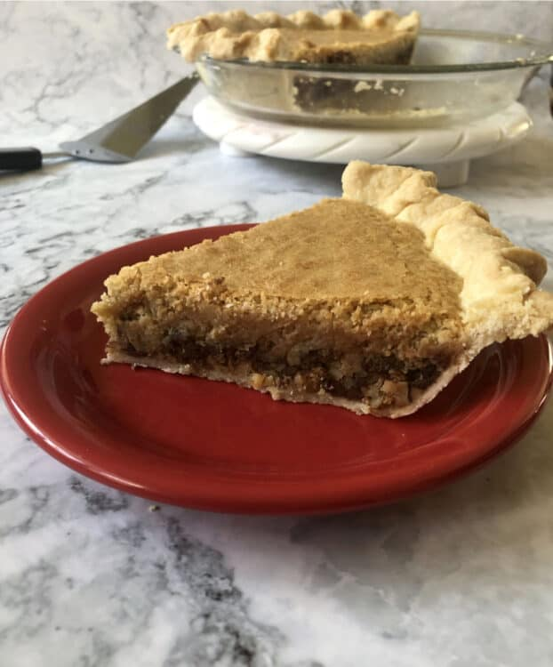 Slice of pie with no topping on a red plate