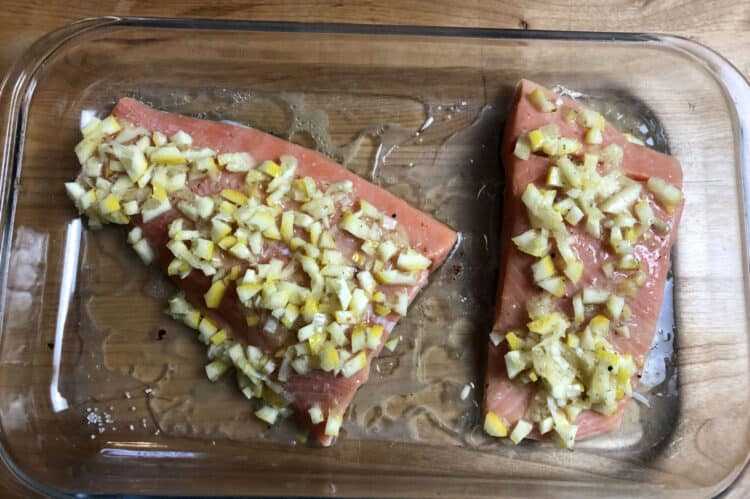 salmon in a 9x13 pan ready to bake