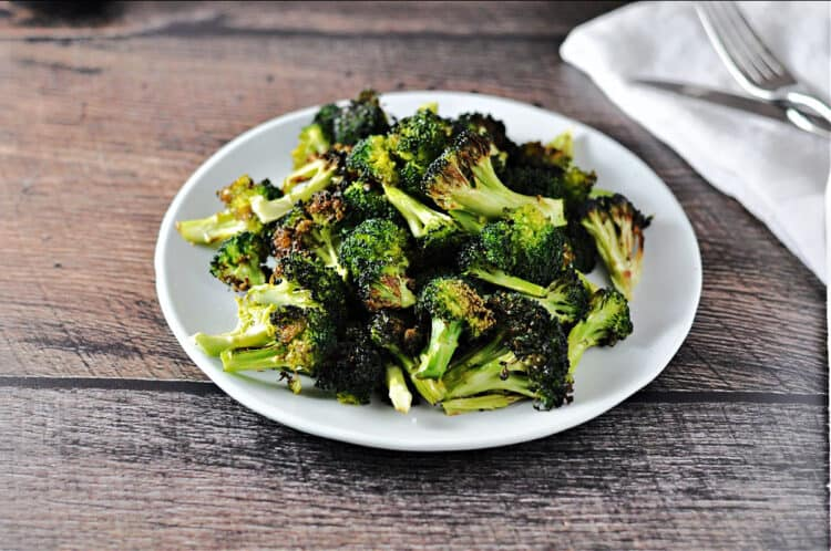 air fryer broccoli on a white plate, viewed from above