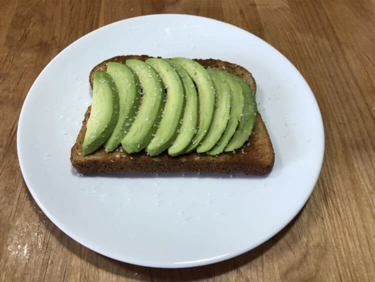 slices of avocado on toast with salt