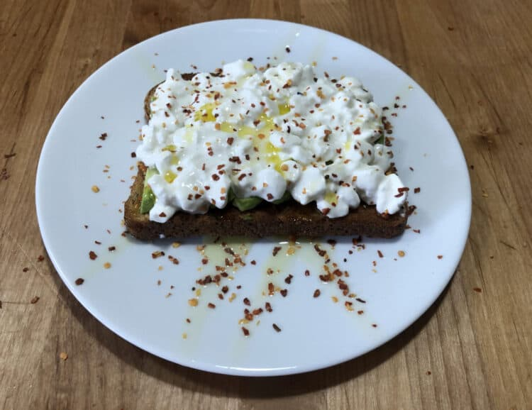 toast with avocado and cottage cheese, sprinkled with red pepper flakes