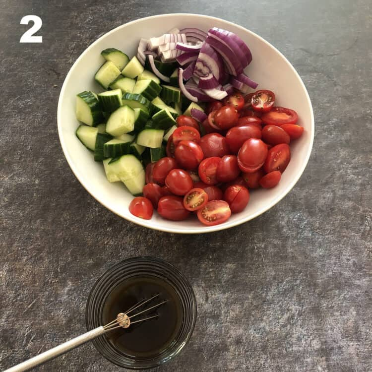 bowl of veggies with balsamic dressing nearby