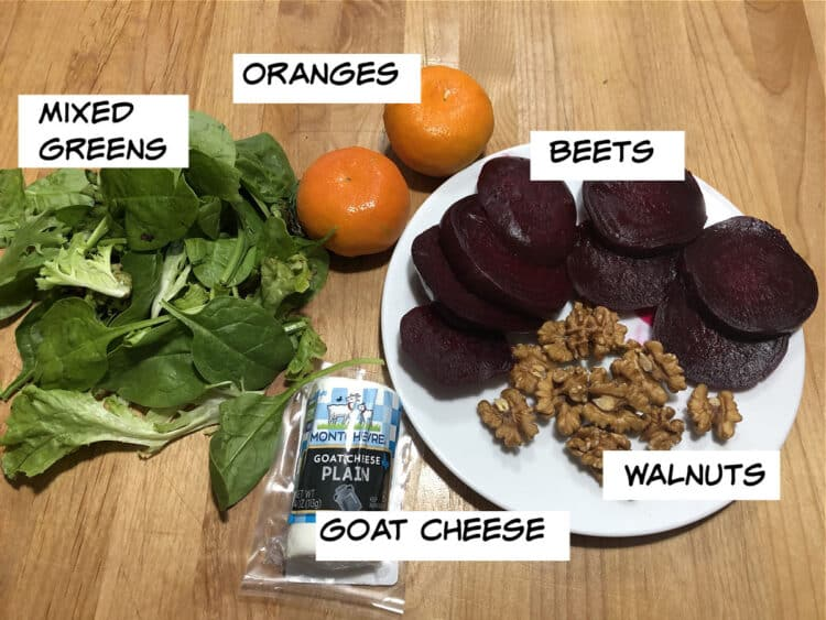 image of labeled ingredients: beets, oranges, mixed greens, walnuts and goat cheese