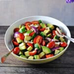 balsamic cucumber tomato salad in a serving bowl