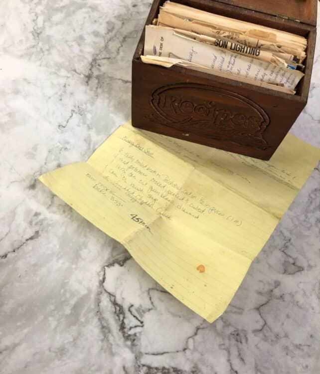 recipe box with yellow paper showing hand written recipe