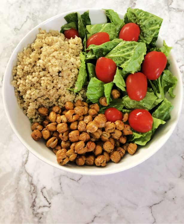 roasted chickpeas in a bowl with quinoa and salad