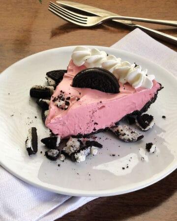 pink koolaid pie on a white plate