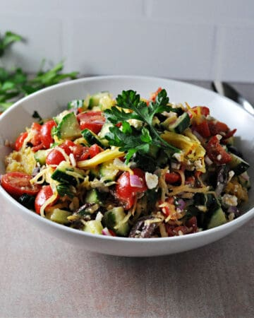 mediterraneam spaghetti squash salad in a serving bowl, looking from above