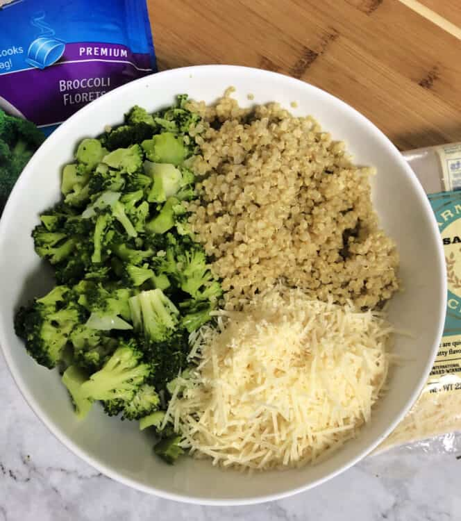 ingredients in a bowl: cooked quinoa and broccoli plus parmesan cheese