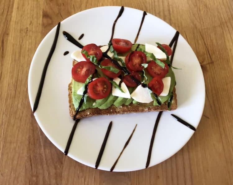 avocado toast with tomatoes, fresh mozzarella and balsamic glaze