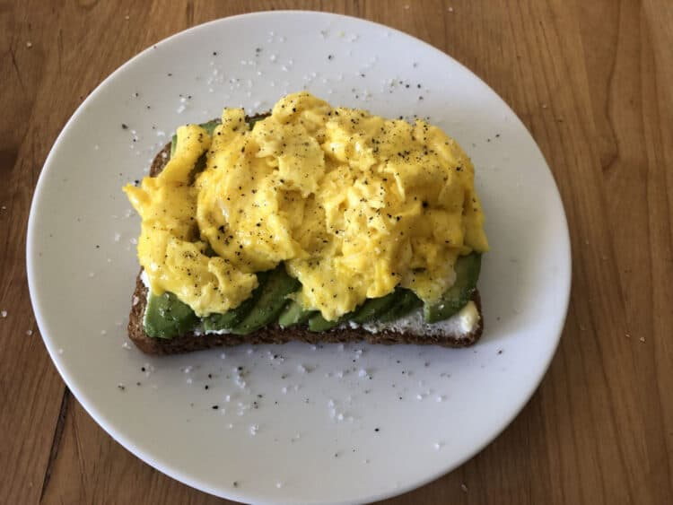 avocado toast with scrambled egg on top