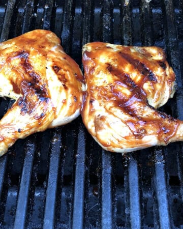 chicken legs on the grill also known as chicken quarters