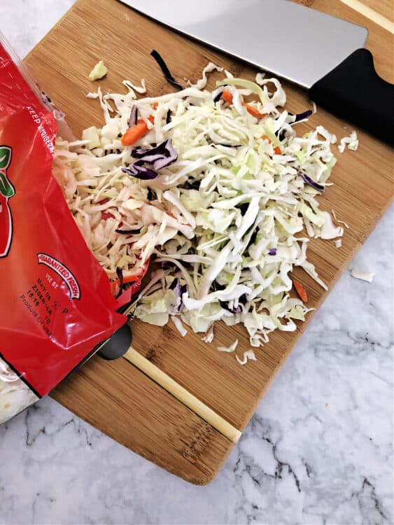 coleslaw mix on a cutting board