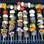 Beef or steak kabobs cooking on the grill