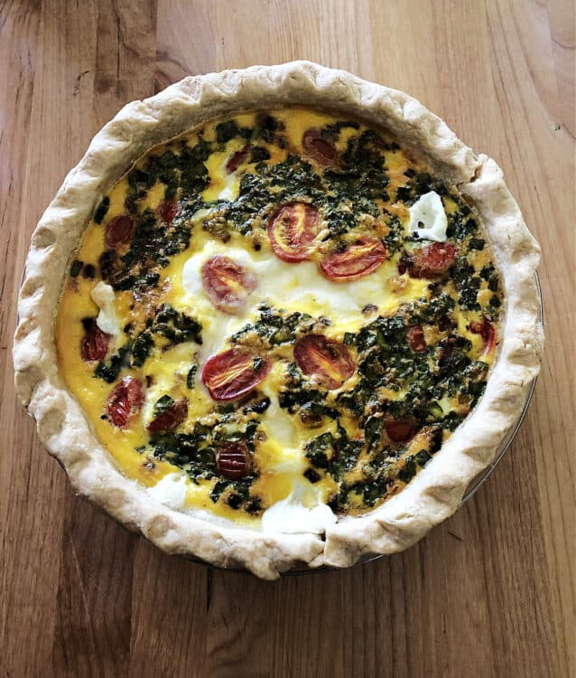 baked quiche resting before being cut