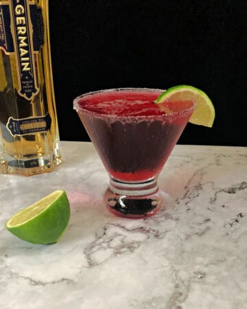 Cranberry Grapefruit Cocktail in a glass garnished with lime