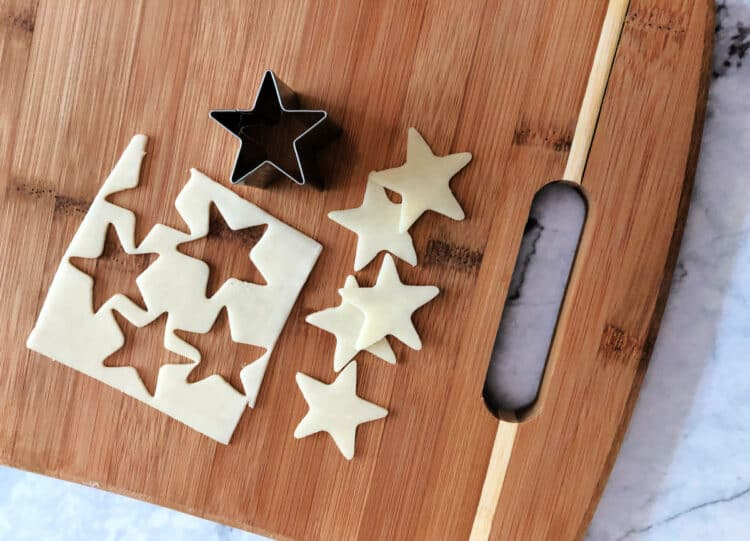 star cookie cutter making star shapes of cheese slices