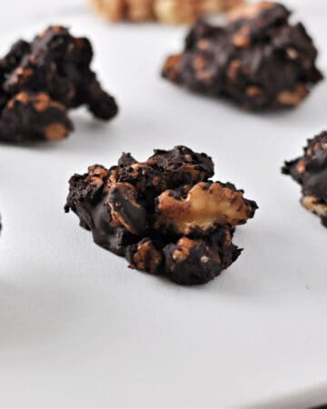 Keto nut clusters on a white board