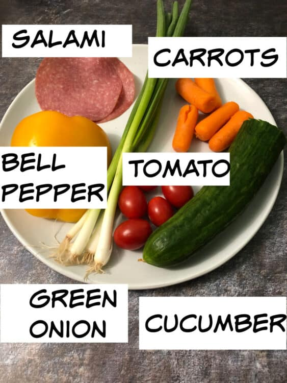 Ingredients before chopping: bell pepper, green onion, timatoes, carrots, cucumber and salami