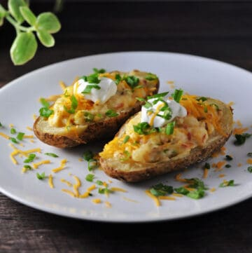 Grilled twice baked potatoes on a white plate
