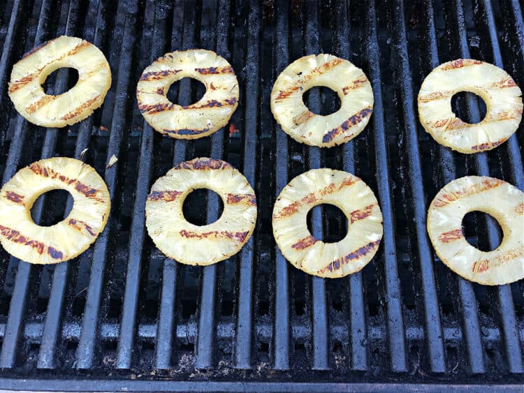 round slices of canned pineapple on the grill