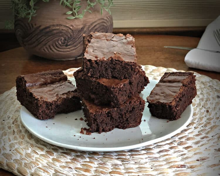 stack of brownies on a small white plate