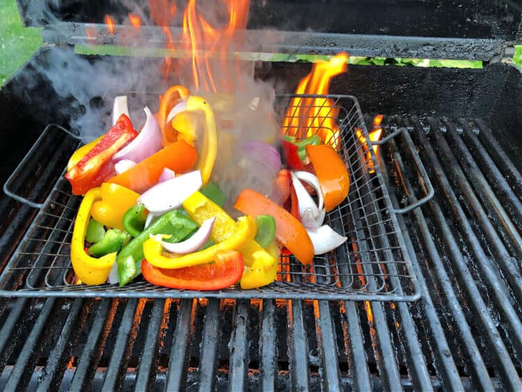 peppers on the grill engulfed by a large flame
