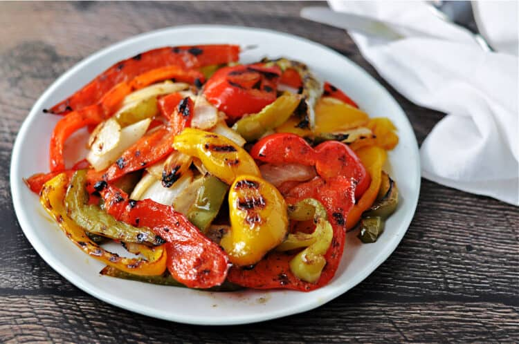 grilled bell peppers and onions on a white plate