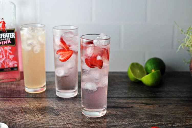 3 pink drinks in tall skinny glasses