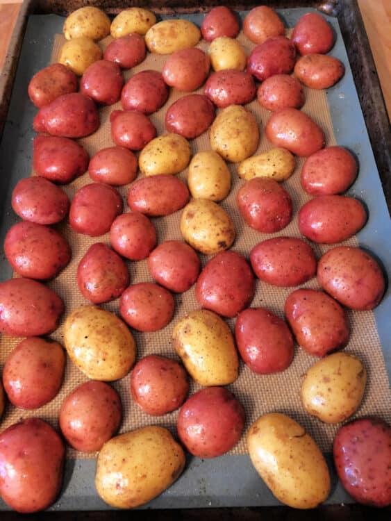 potatoes on a sheet pan, cut side down