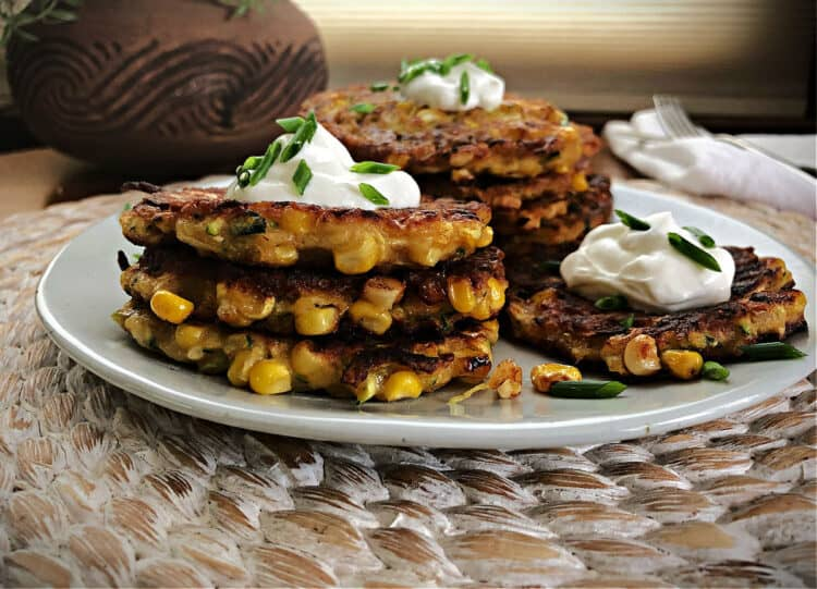 corn fritters with zucchini in a stack on a plate