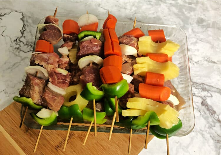 assembled kebabs in a pan, before cooking