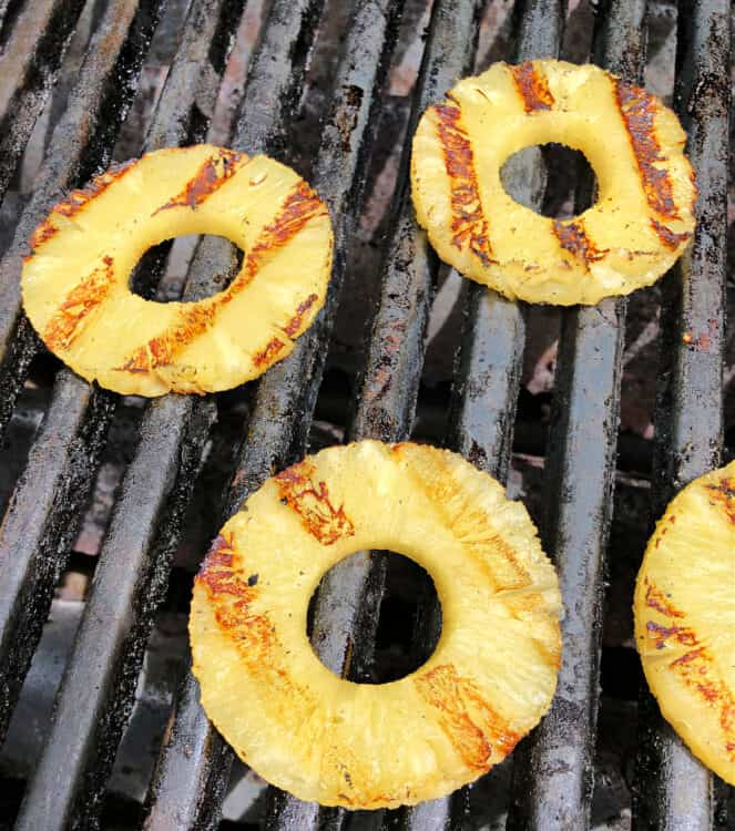 pineapple rings cooking directly on grill grates