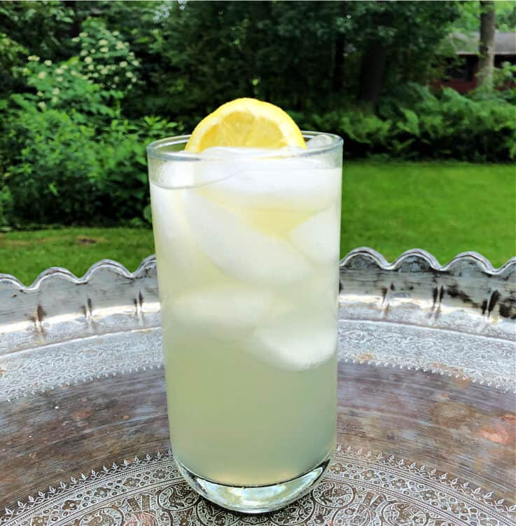 glass of lemonade on a table outdoors