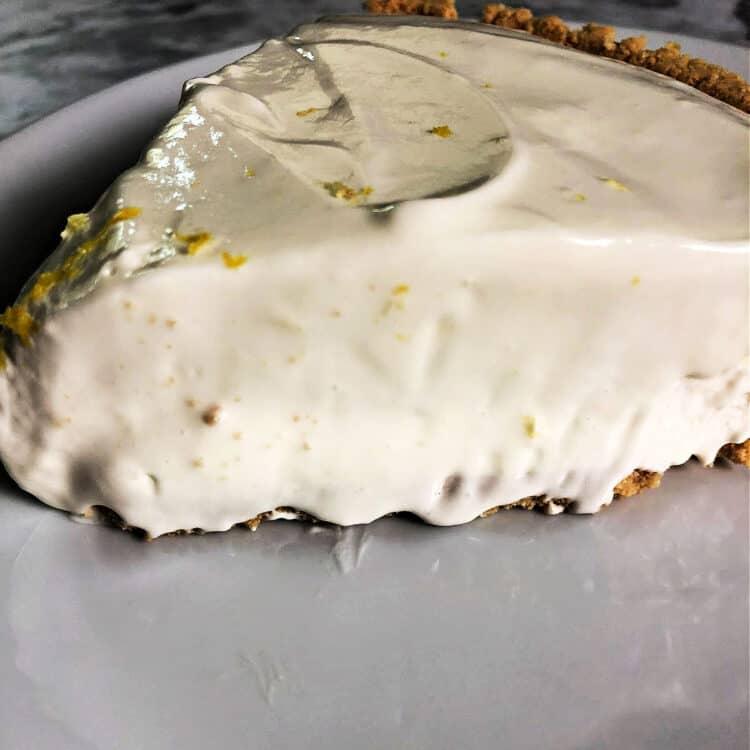 slice of lemonade pie on a white plate